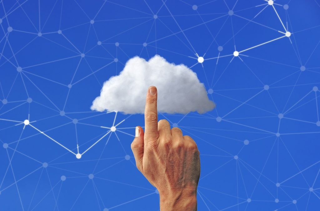A finger pointing to a white cloud over a blue background to show nonprofit cloud hosting